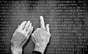 "At the traveling Vietnam War Memorial Wall at Hillcrest Memorial Park Saturday afternoon June 26, 2008, the hands of Sandra Zeberg, left, and Peggy .Berryman search the names for a high school classmate who was killed in the Vietnam War. ""The Wall"" (4 of 10)"