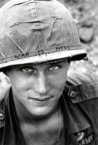 an-american-soldier-wears-a-hand-lettered-war-is-hell-slogan-on-his-helmet-vietnam-1965