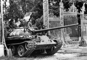 ADVANCE FOR -- -- USE SATURDAY, APRIL 25, 2015, AND THEREAFTER- FILE - In this April 30, 1975 file photo, a North Vietnamese tank rolls through the gates of the Presidential Palace in Saigon, signifying the fall of South Vietnam. The war ended on April 30, 1975, with the fall of Saigon, now known as Ho Chi Minh City, to communist troops from the north. (AP Photo/File)